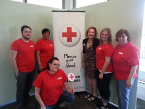 DKI Blood Drive with team members posing for picture