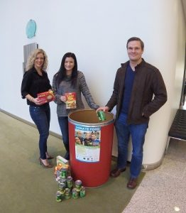 DKI members posing with food drive donations for their location