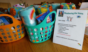 Baskets of blankets and toys for charity