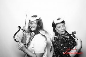Two women posing for a photo in Chic Palooza photobooth