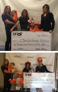Families posing with large oversized check at DRS Gold Charity