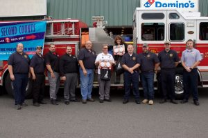Granby Fire Department employees pose for a picture at Dominos event