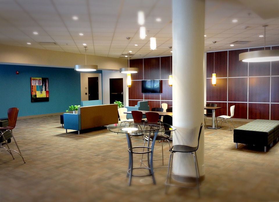 Newly renovated lobby with chairs, couches and lighting