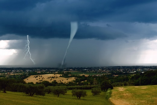 Tornado and lighting storm in an open field