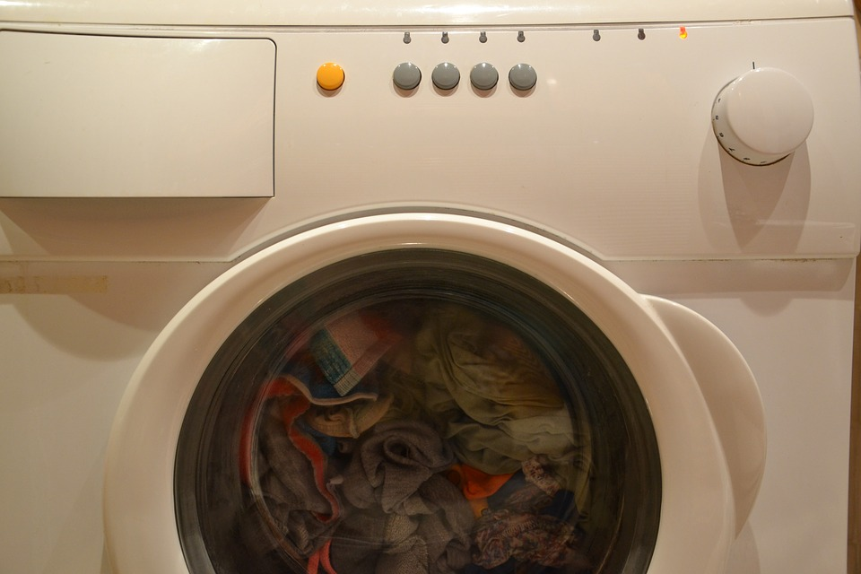 Washer with clothes being cleaned in a home