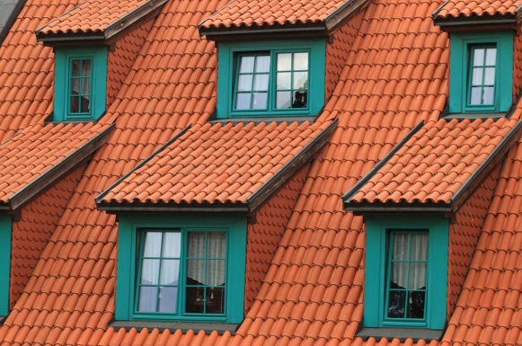 Orange rooftop with green window panes