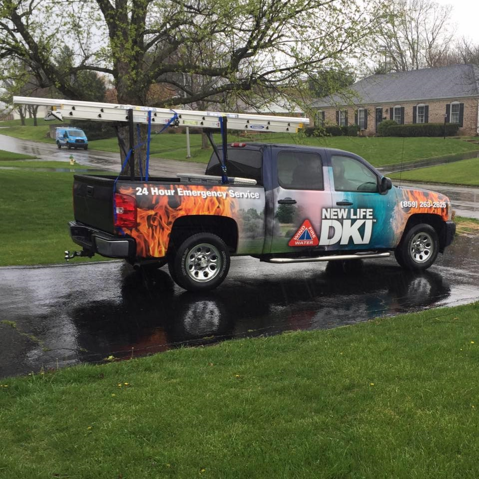 New Life DKI Service Truck parked on wet driveway
