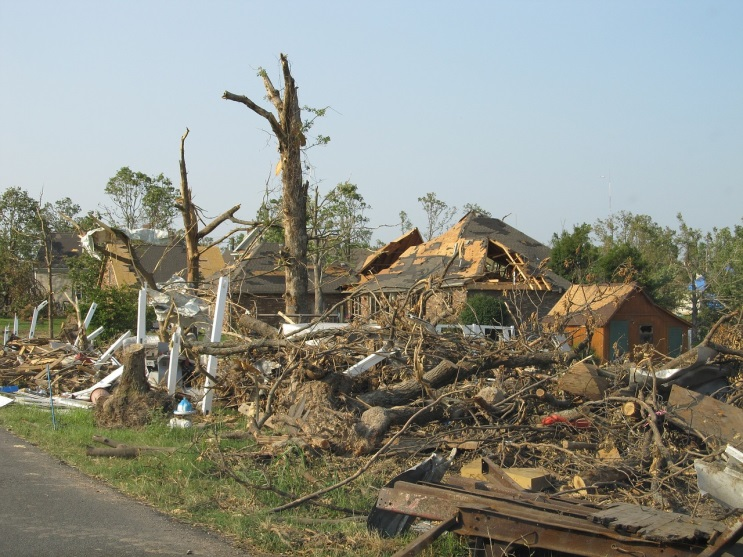 Trees and homes in a neighborhood destroyed by a storm