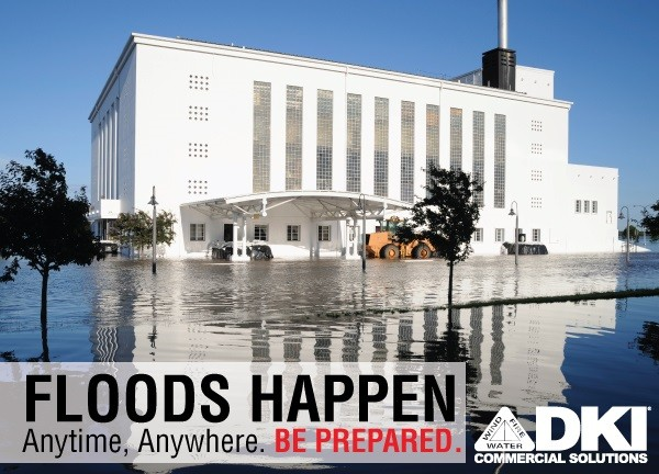 DKI Commercial Solutions Floods Happen Graphic with grass and sidewalks around building flooded