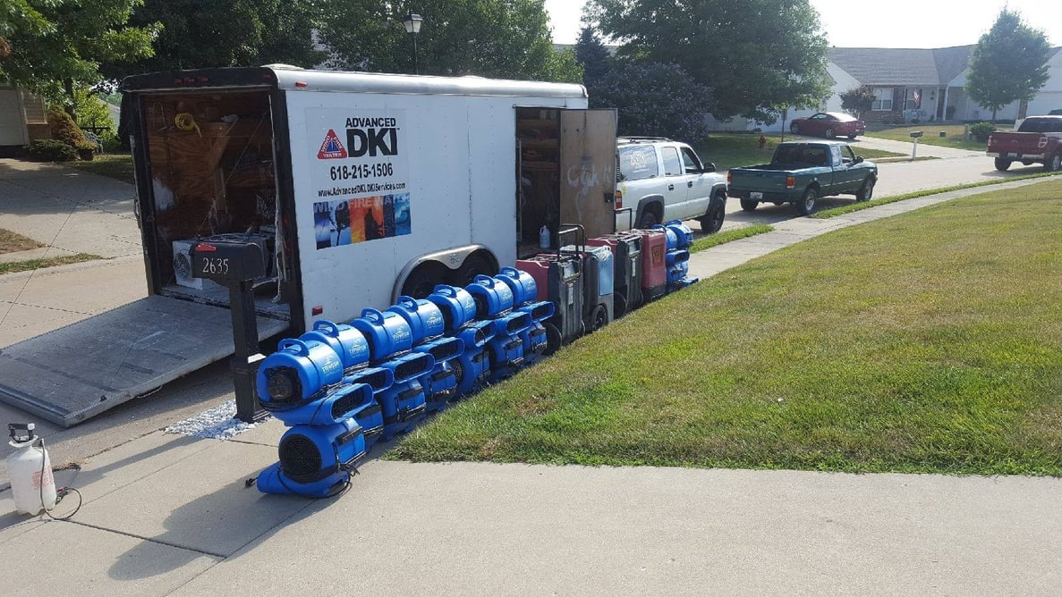 Advanced DKI truck with unloaded drying fans sitting next to it 2
