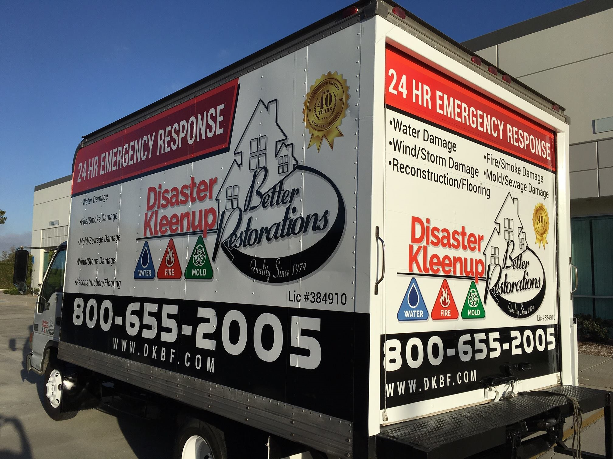 Disaster Kleenup Better Restorations service truck parked in front of a business