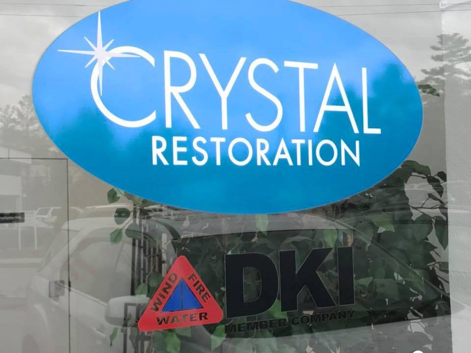 Crystal Restoration a DKI member company business sign on front entrance of building
