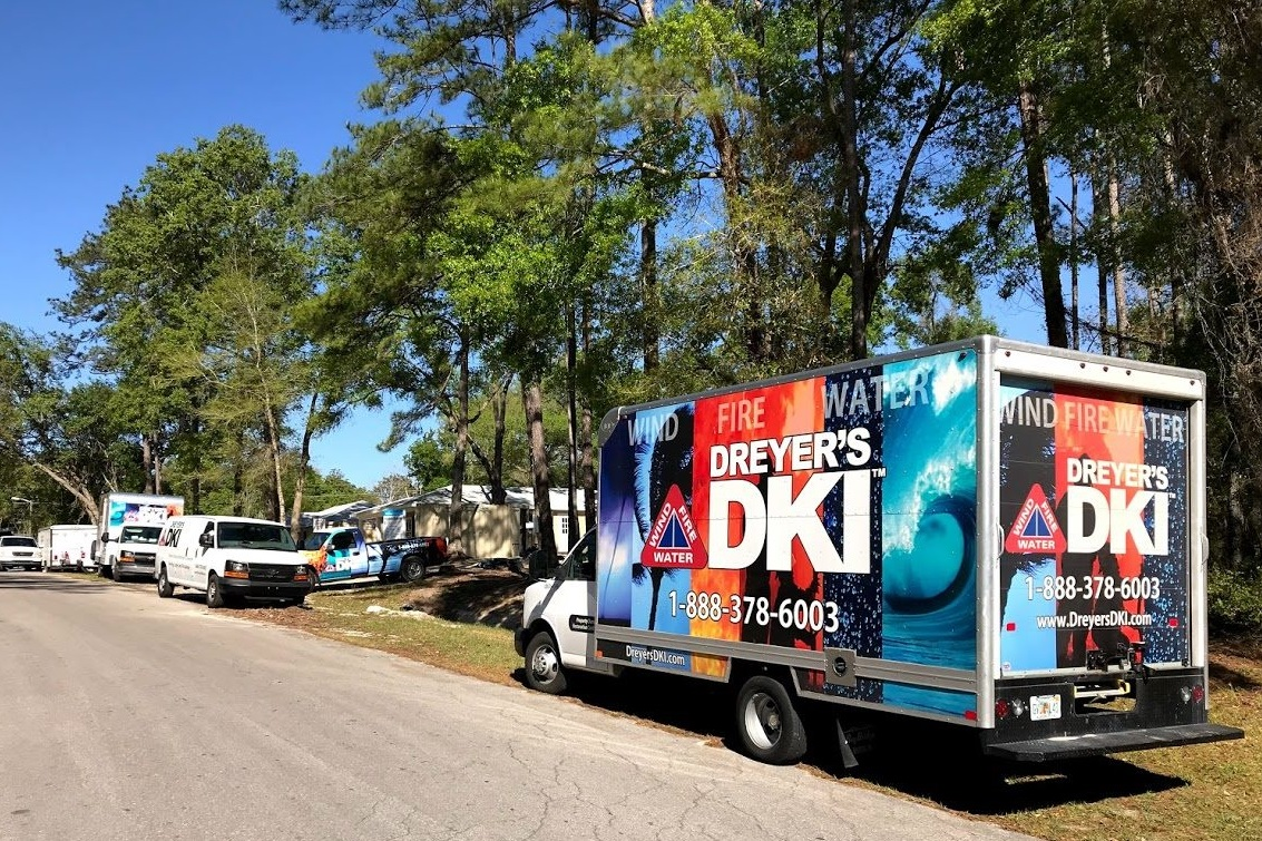 Dreyer's DKI service trucks parked on the side of the road