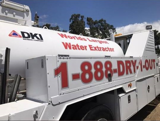 DKI World's Largest Water Extractor service truck in parking lot