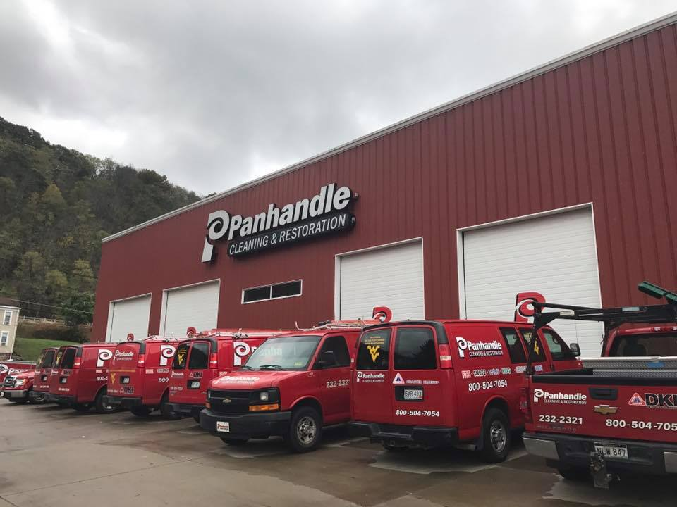 Panhandle Cleaning and Restoration trucks outside of business