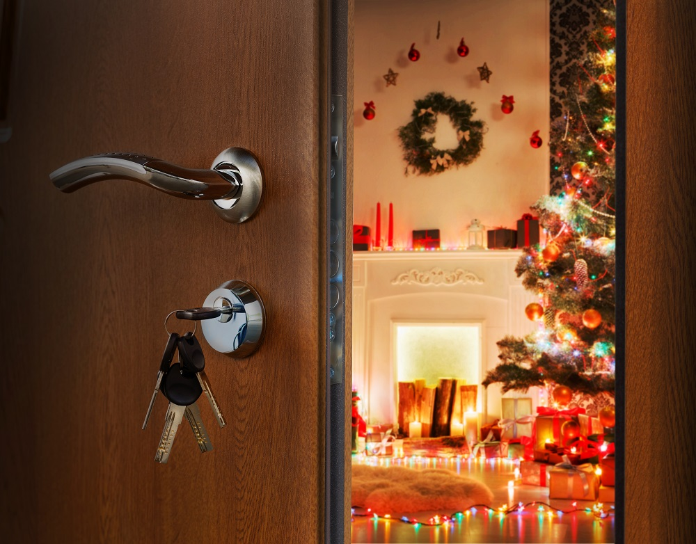 Open doorway with keys still in door with holiday decorations set up inside the room