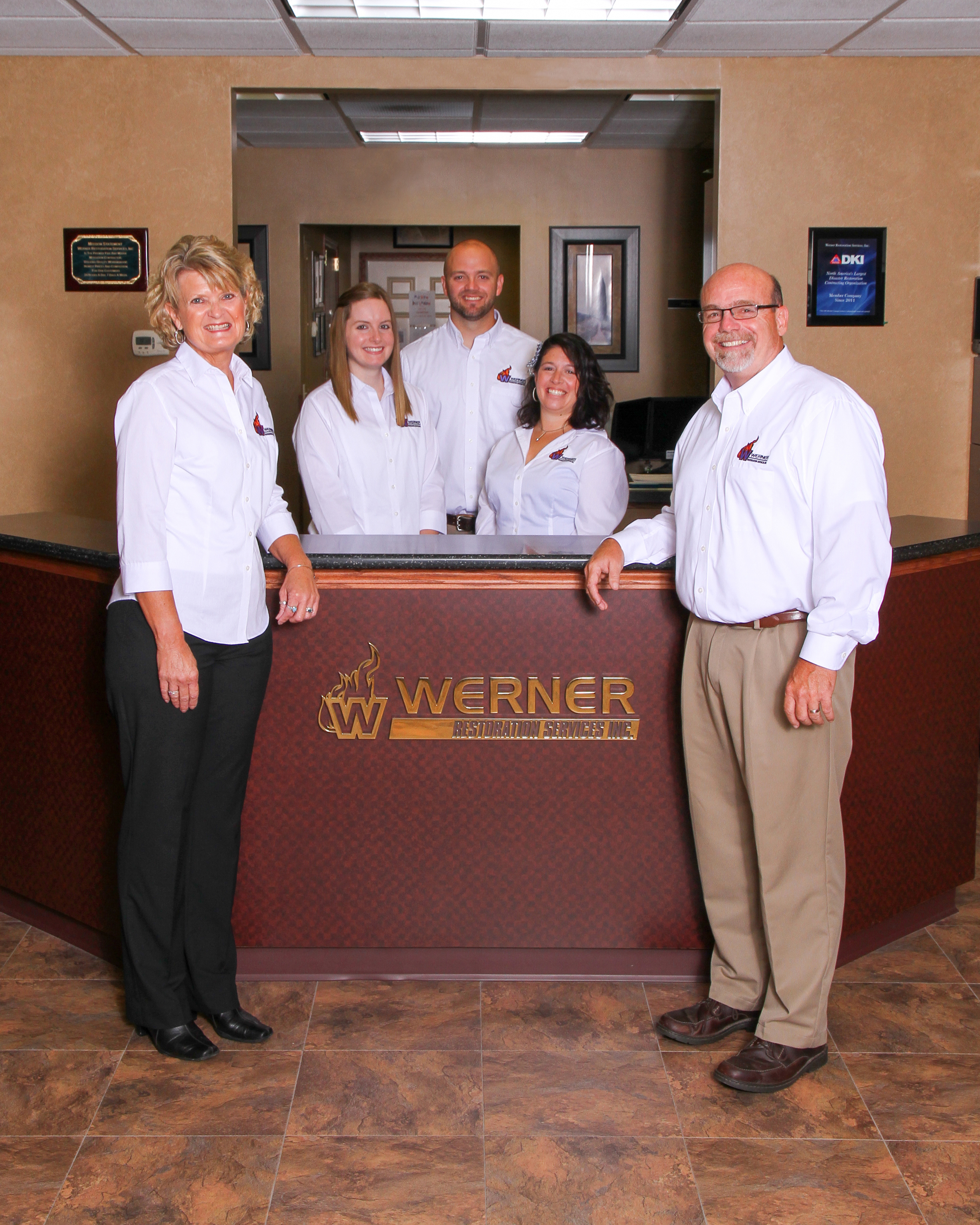Werner Restoration services members pose for a picture at their office