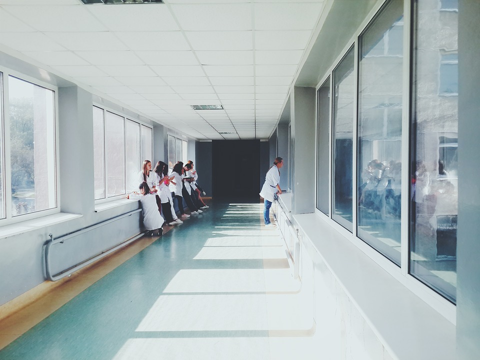 Doctors and nurses in the hallway of a hospital