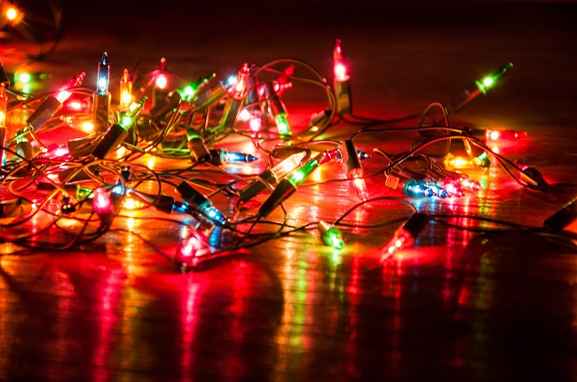 A string of holiday lights glowing