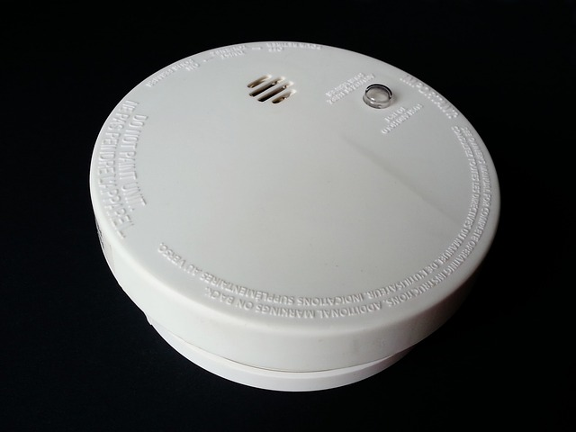 Smoke detector on black background