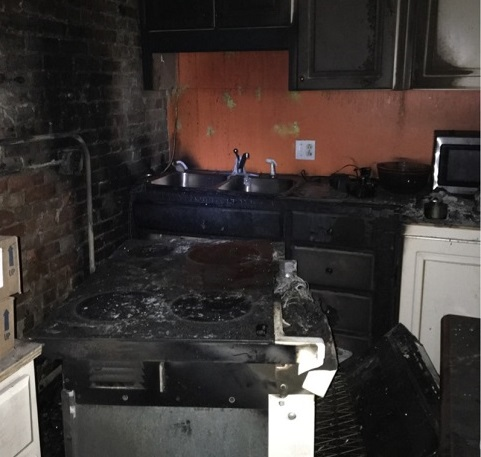Burned appliances, counters and cabinets in a kitchen after a fire