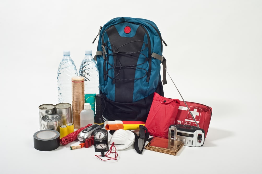 Emergency preparedness kit with a backpack, food, water, and other supplies 2