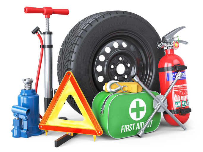 A set of automotive accessories. Spare wheel, fire extinguisher, first aid kit, emergency warning triangle, jack, tow rope, wheel wrench, pump.