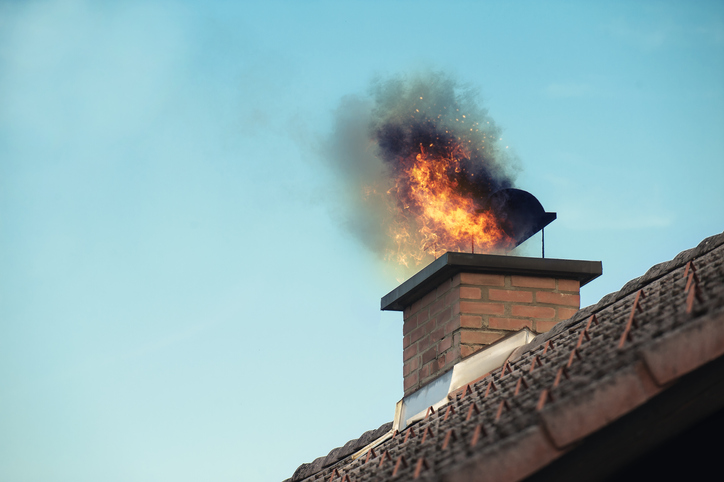 Fire and smoke coming out of a home's chimney