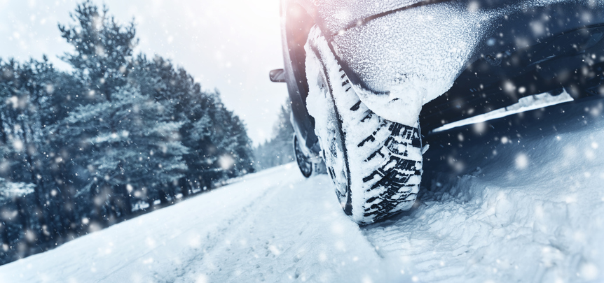 Closeup of car tires in winter on the road in IL