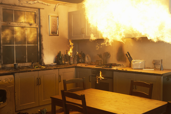 Fire raging in domestic kitchen at night