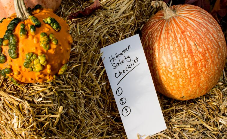 Halloween safety checklist wiThe pumpkins on haystack