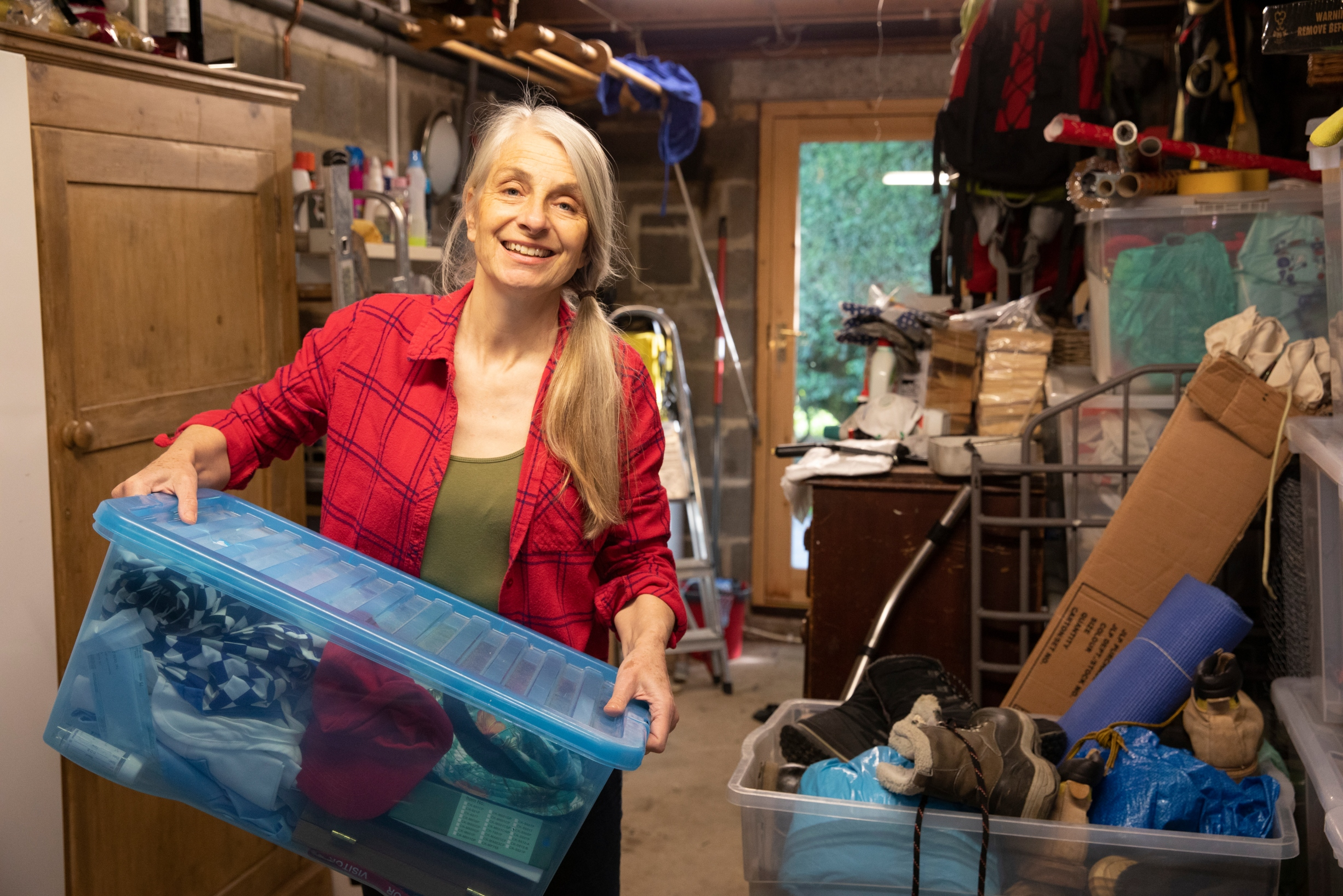 Women Decluttering her house