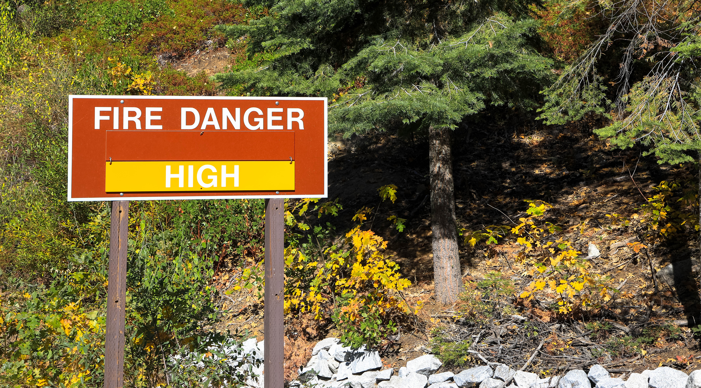 A sign in the Yosemite national park warns residents of the high wildfire danger in summer